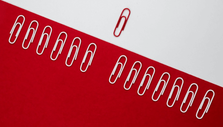 white and red paper clips representing Amazon email attachments