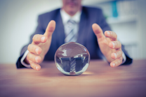 business man with crystal ball predicting Amazon costs