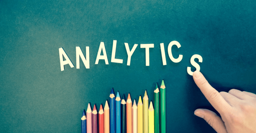 The word analytics, and pencil crayons as the graph
