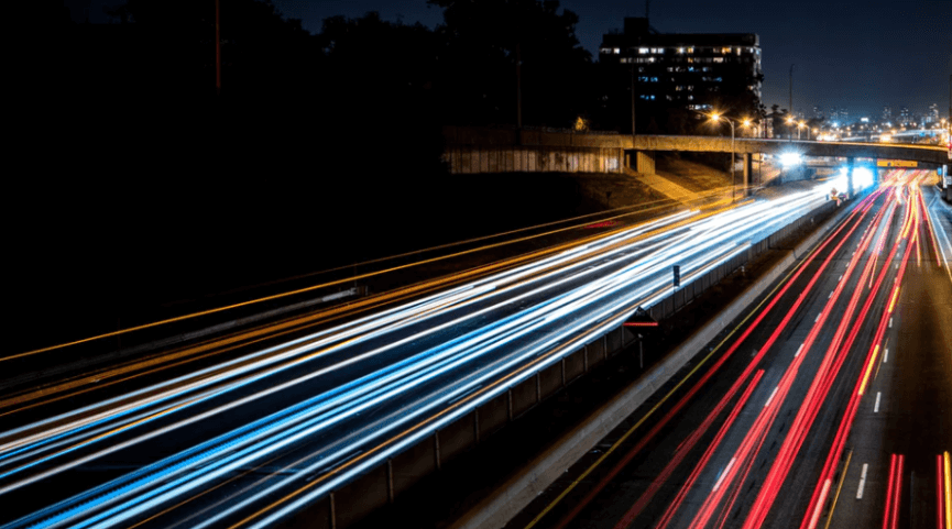 time-lapse photography of traffic driving at night