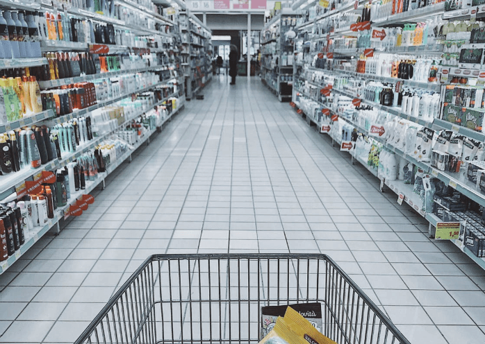 Amazon vs Dollar Tree: grocery store aisle