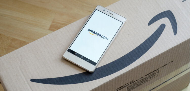 Amazon Request Review: Amazon box and cell phone