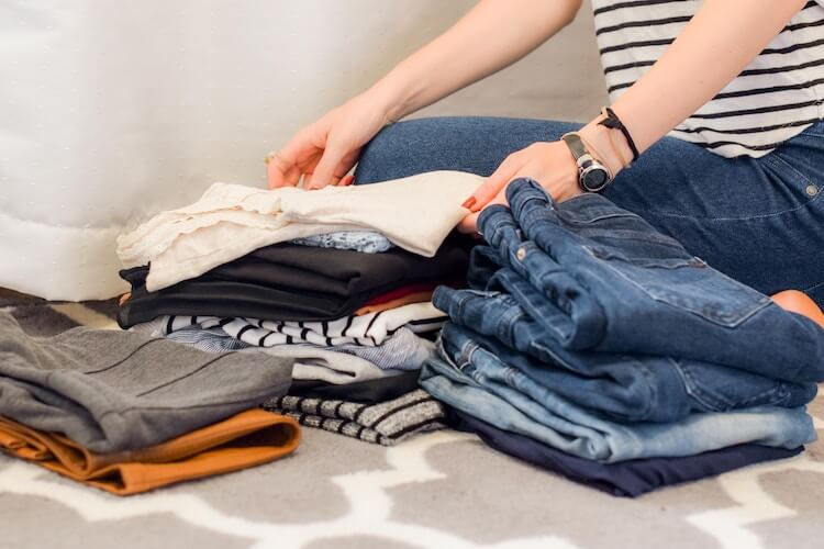 KonMari and selling online: image of woman folding clothes