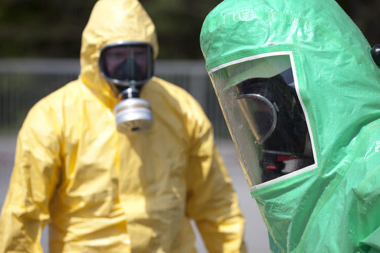 Coronavirus: People in hazmat suits