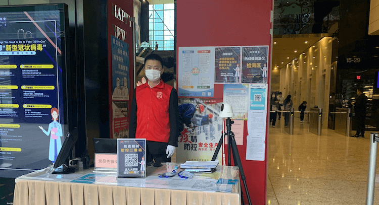 Living in China with Coronavirus: health check at building entrance