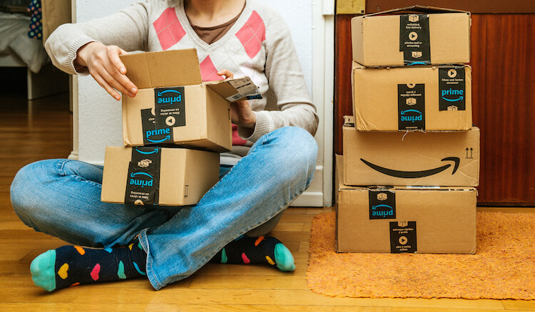 Amazon Prime members: customer opening a box from Amazon
