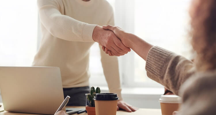 Amazon business financing: shaking hands in agreement